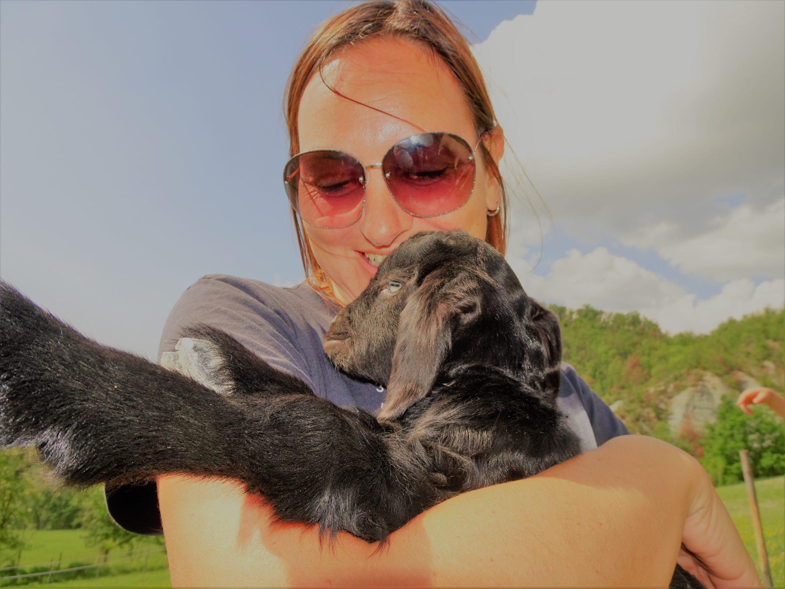 goat cuddling in italy